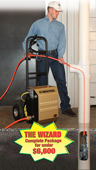 Cheerful young man using a vacuum cleaner